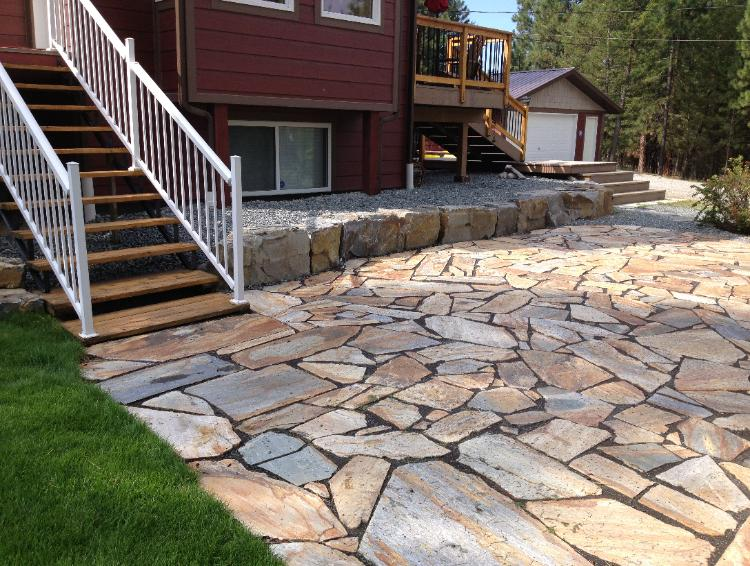 retaining wall with quartzite patio.